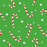 Christmas seamless pattern with candy canes, snow ball on green background. Background for wrapping paper, fabric print. Greeting cards. Winter Holiday design Stock Images