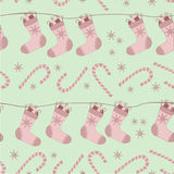 Christmas seamless pattern with socks and canes Royalty Free Stock Photography