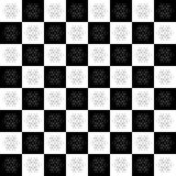 Christmas seamless pattern on chessboard background. New Year wallpaper. Winter black and white wrapping with snowflakes. Royalty Free Stock Photos