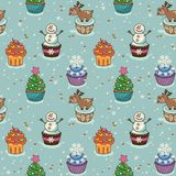 Christmas seamless pattern with cupcakes Royalty Free Stock Images
