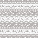 Christmas seamless pattern with deer and holly. Royalty Free Stock Photo