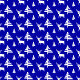 Christmas seamless pattern with deers and pine trees. Stock Images