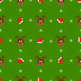 Christmas seamless pattern. Deers and red hats Stock Image