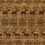 Christmas seamless pattern with deers and snowflakes Stock Images
