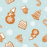 Christmas seamless pattern. Different Gingerbread cookies on pastel blue. Vector Stock Images
