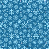 Christmas seamless pattern of different snowflakes Stock Photos