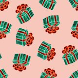 Christmas seamless pattern drawn by hand. Blue gift with red ribbon on a pink background. Happy New Year royalty free illustration