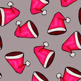 Christmas seamless pattern drawn by hand. Red Santa Claus hat on a grey background. Happy New Year royalty free illustration