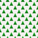 Christmas seamless pattern with geometrical fir-trees. Royalty Free Stock Photos