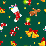 Christmas seamless pattern gingerbread man cookies, jingle bells stocking gifts, xmas background decoration elements. Christmas seamless pattern with gingerbread Royalty Free Stock Images