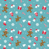 Christmas seamless pattern with gingerbread man, mittens, bells and snowflakes. Stock Photo