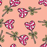 Christmas seamless pattern hand-drawn. New Year candy on a pink background.Happy new year. Lollipop drawing heart illustration design card decoration wallpaper stock illustration