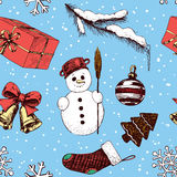 Christmas seamless pattern. With hand drawn snowman, bells, gift, and Christmas decorations Royalty Free Stock Photo