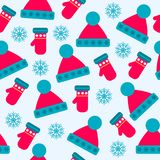 Christmas seamless pattern with hats, gloves and snowflakes stock illustration