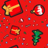 Christmas seamless pattern with holiday toys and symbols in flat cartoon style. Bauble, gift, sugar cane and Christmas Tree Royalty Free Stock Photos