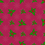 Christmas seamless pattern. With holly berries on red background Royalty Free Stock Photo