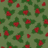 Christmas seamless pattern holly berry with green leaves and red Stock Images