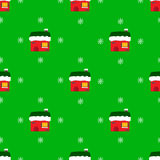 Christmas seamless pattern with houses. On green background Royalty Free Stock Photos
