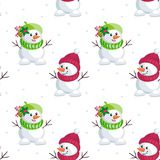 Little cute snowmen. Christmas seamless pattern with the image of snowmen in cartoon style. Vector colorful background Royalty Free Stock Photography