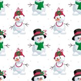 Snowmen in beautiful hats Royalty Free Stock Photo