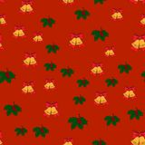Christmas seamless pattern with jingle bells, and holly leaves on red background,  Royalty Free Stock Photography