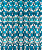 Christmas seamless pattern. Knitting  traditional texture.   Blue winter background. Stock Image