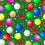 Christmas seamless pattern. With multicolor balls, red bows and fir branches on green background Royalty Free Stock Photography