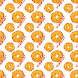 Christmas seamless pattern with oranges and candy canes on white background. watercolor holiday illustration. Stock Image