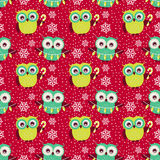 Christmas seamless pattern with owls. Vector background. Merry Christmas! Cute seamless pattern with owls and snowflakes. Winter holidays theme. Colorful vector Stock Photography