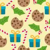 Christmas seamless pattern with presents, candy canes and mistle royalty free illustration