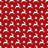 Christmas pattern of red with deer and snowflakes. Christmas seamless pattern of red with deer and snowflakes Royalty Free Stock Photo