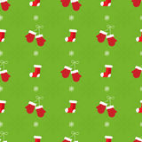 Christmas seamless pattern. Red mitens and socks Stock Images