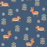 Christmas seamless pattern with reindeer. Seamless pattern with reindeer, Christmas tree and snowflakes on a blue background. Vector illustration Stock Photo