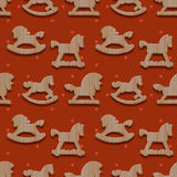 Christmas seamless pattern with rocking toys horses Stock Image