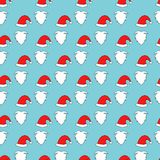 Christmas Seamless pattern of Santa hats, moustache and beards. Royalty Free Stock Photos