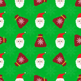 Christmas seamless pattern. With santa's faces and bags Royalty Free Stock Photos
