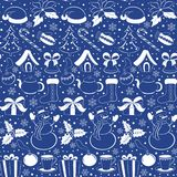 Christmas seamless pattern. Silhouettes of winter elements and symbols on a blue background. Sketch hand drawing style. Vector Royalty Free Stock Photography