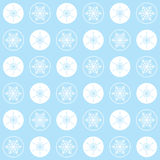 Christmas seamless pattern snowflakes on a blue background, pastel colors. Christmas seamless pattern with white circles and elegant white snowflakes on a blue Royalty Free Stock Images