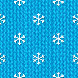 Christmas seamless pattern with snowflakes on blue knitted background Stock Images