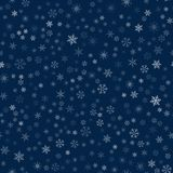 Christmas seamless pattern from snowflakes. New year festive texture for design postcards, invitations, greetings, and clothing. Vector illustration Stock Image