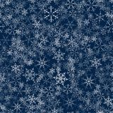Christmas seamless pattern from snowflakes. New year festive texture for design postcards, invitations, greetings, and clothing. Vector illustration Royalty Free Stock Photo