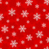 Christmas seamless pattern with snowflakes on a red background Stock Image