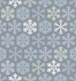 Christmas seamless pattern with snowflakes in Stock Images
