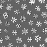 Seamless pattern of snowflakes with shadows. Christmas seamless pattern of snowflakes with shadows, white on gray background Royalty Free Stock Images