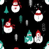 Christmas Seamless Pattern Of Snowmans. Hand drawn Christmas seamless pattern with funny snowmans in hats and scarfs Royalty Free Stock Image
