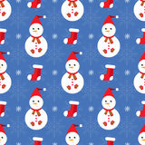 Christmas seamless pattern. With snowmen and red socks Royalty Free Stock Images
