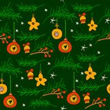 Christmas seamless pattern with spruce branches. Berries and stars on blue background. Winter theme Stock Images