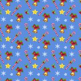 Christmas seamless pattern with stars, snowflakes, Xmas bells and candies. On blue background. Hand drawn elements Royalty Free Stock Photos
