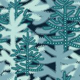 Christmas seamless pattern with stylized snowy Christmas trees. stock photo