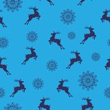 Christmas seamless pattern. Christmas Symbols. Vector illustration. Christmas seamless pattern with deers and snowflakes on a blue background.vector illustration royalty free illustration